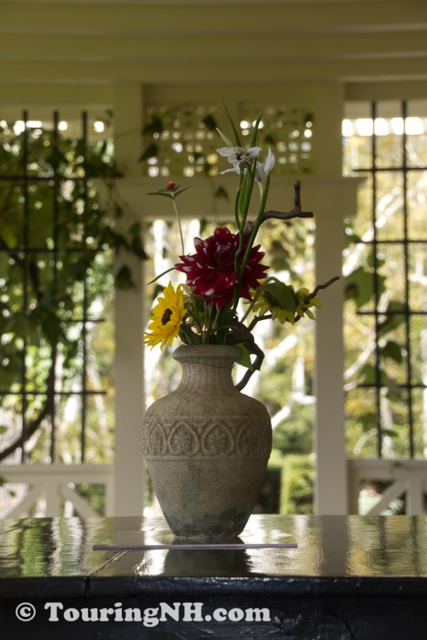 Flowers on the porch are from the gardens Saint-Gauden designed
